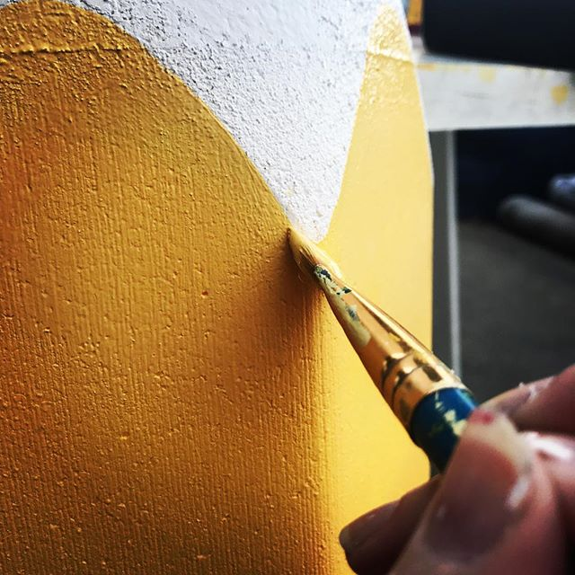With a steady hand👩🏻‍🎨 The production team at work. . . . . . #bts #handpainted #slowandsteady #finerdetails #yellowpaint #installationart #brush #walldecor #artandcraft #kidsdesign #pencildesign #visualmerchandising #vmlife #productiondesign #propstylist #custommade #madetoorder #artistatwork #aminiconcepts #thestyledgroup #visiondesigncreate