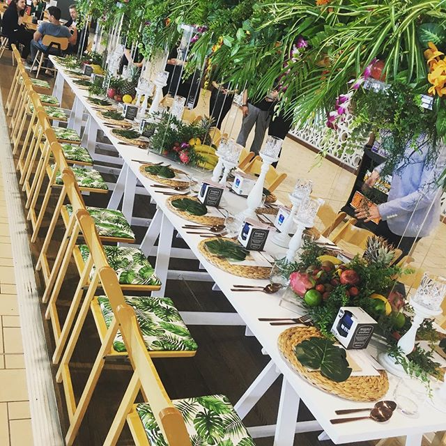 Looking back at this luscious lunch styling for @brisbaneairport Paddock to Gate Brunch. 🍃🌿 . . . . . #customchairpads #tropicaltablescape #finerdetails #tropicaltheme #brunch #tablesetting #lush #tropicana #tablescape #longlunch #gormet #paddocktoplate #americanachairs #corporatestyling #restaurantdesign #eventstylist #tablecenterpiece #aminiconcepts #thestyledgroup #visiondesigncreate #foodblogger