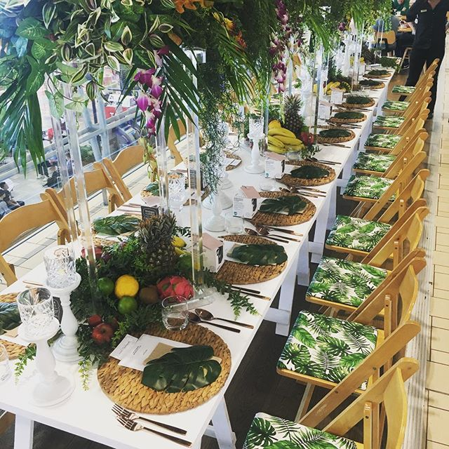 Tropical Tablescape for Brisbane Airport Paddock to Gate Brunch 🌿 . . . . . #customchairpads #tropicaltablescape #finerdetails #tropicaltheme #brunch #tablesetting #lush #tropicana #tablescape #longlunch #gormet #paddocktoplate #americanachairs #corporatestyling #restaurantdesign #eventstylist #tablecenterpiece #aminiconcepts #thestyledgroup #visiondesigncreate #foodblogger
