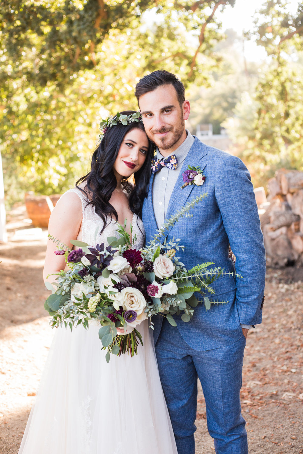 Rustic and Moody bride and groom with dark florals