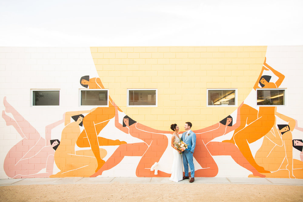 Bride and Groom in front of Laura Berger mural in Palm Springs