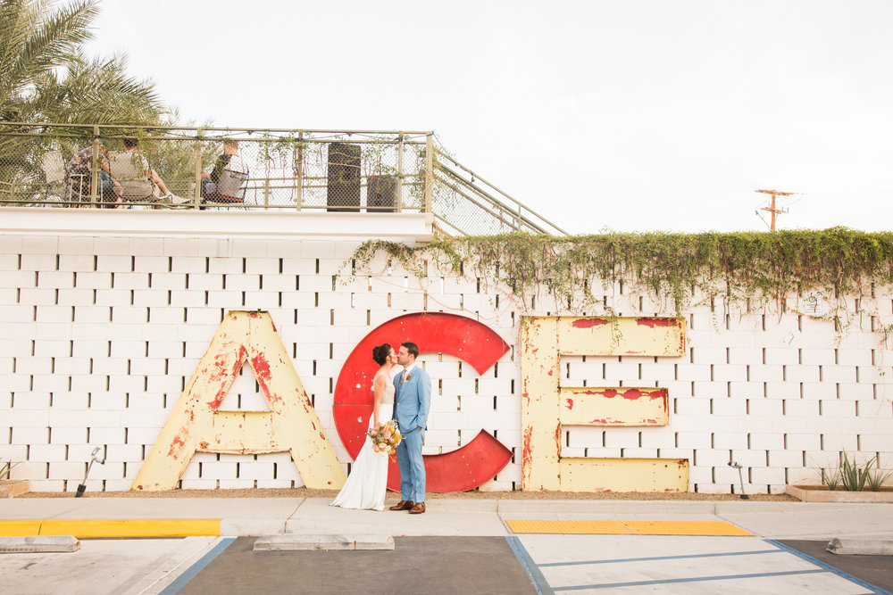 Couple kissing in front of Ace Hotel Palm Springs