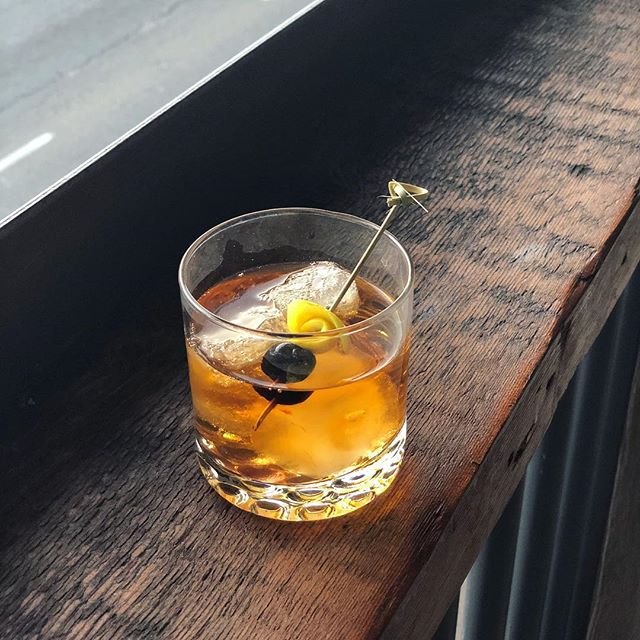 Old fashioned made delicious. 🍊 🥃  Find your drink of choice at our bars @arcademissioncontrol @lostartbar! 🎈🎊 Cheers! #mcfaddenpublicmarket #dtsantaana #bars #nightlife #arcadebar #santaana #orangecounty #oc