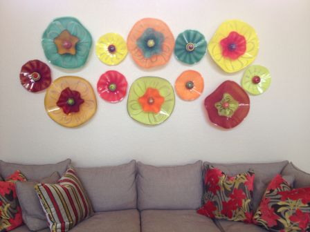 Glass flowers above sofa