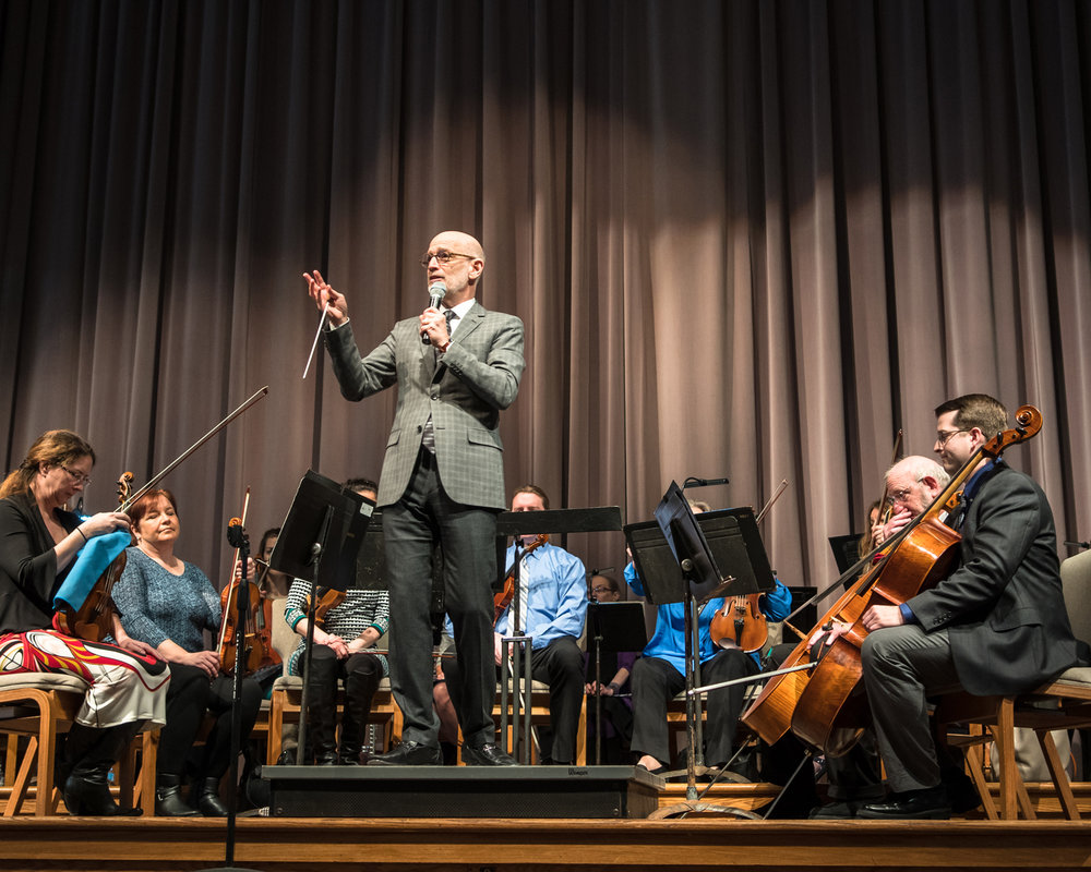 Racine Symphony Orchestra Conductor Pasquale Laurino greets students visiting from schools throughout the Racine area for the Concert for Fifth Graders, held Tuesday at Grace Church on Highway 31 in Caledonia