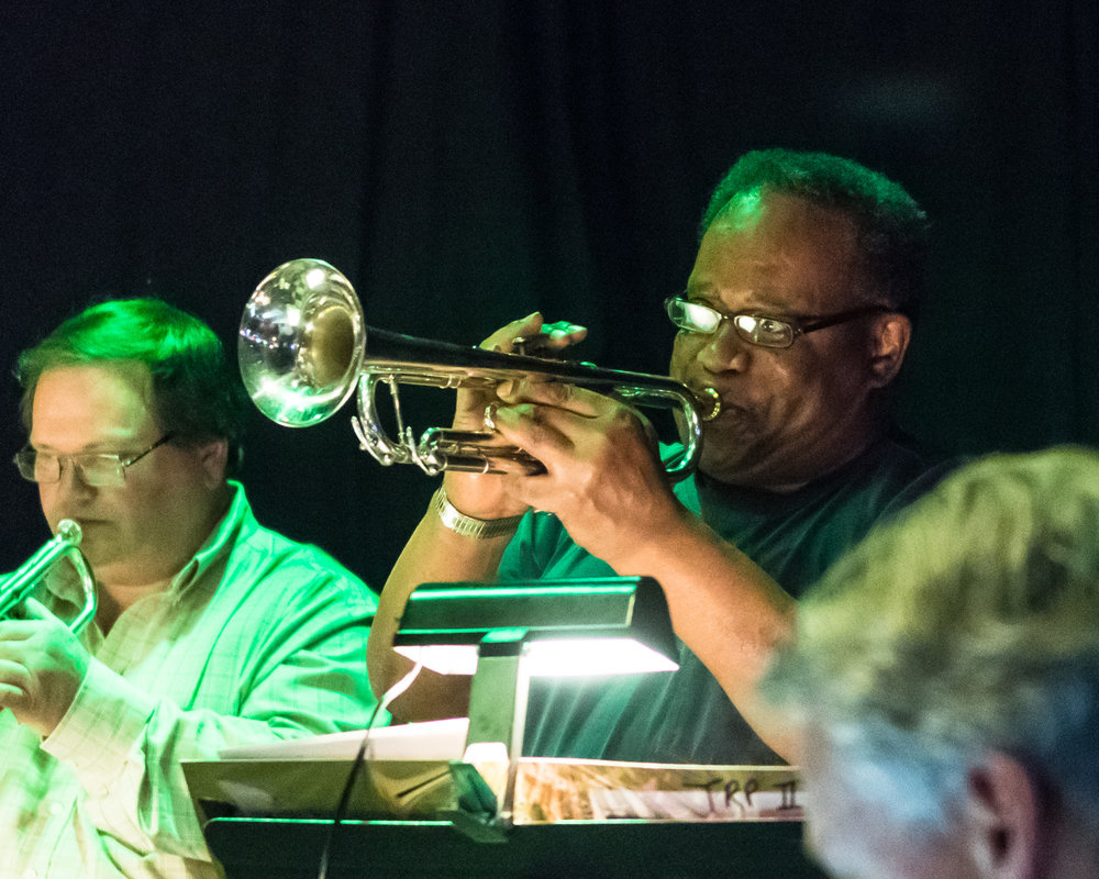 Trumpet player Allen Johnson plays a solo during The Parkside Reunion Big Band's bi-weekly performance April 4 at McAuliffe's Pub. Throughout his lifetime Johnson has played with famed jazz performers such as pianist Count Basie and Maynard Ferguson.