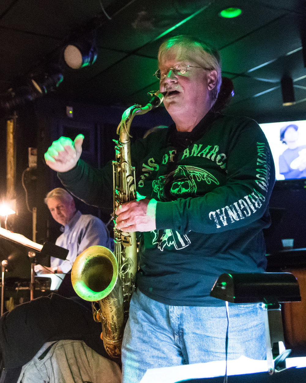 Tenner Saxophone Patrick Odell signals the band to finish playing at The Parkside Reunion Big Band's bi-weekly performance April 4 at McAuliffe's Pub.