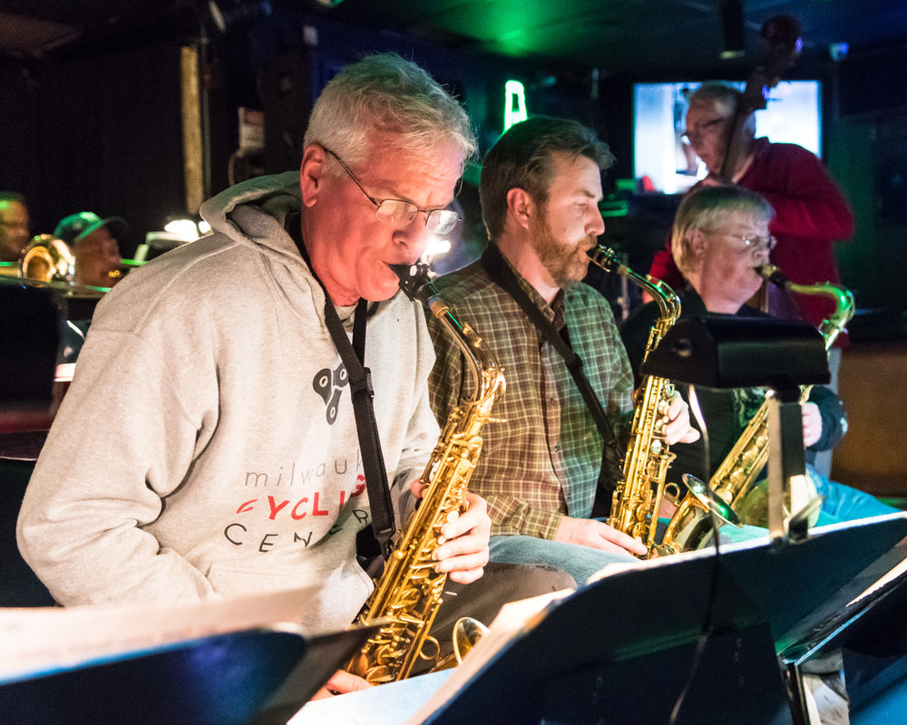 Groovin' in Georgetown -Steve Jacob, left, playing alto saxophone, performs high notes and fast riffs during his solo with The Parkside Reunion Big Band's bi-weekly performance on April 4 at McAuliffe's Pub in Racine's Georgetown neighborhood.