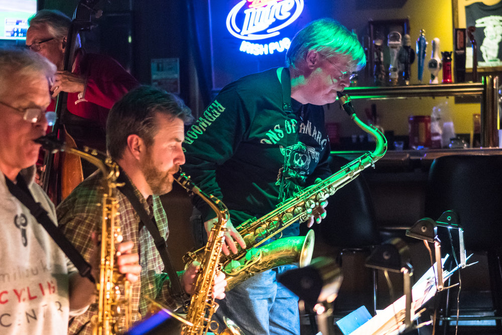 Patrick Odell, tenor saxophone, stands for a solo with The Parkside Reunion Big Band at their performance at McAuliffe's Pub on April 4.