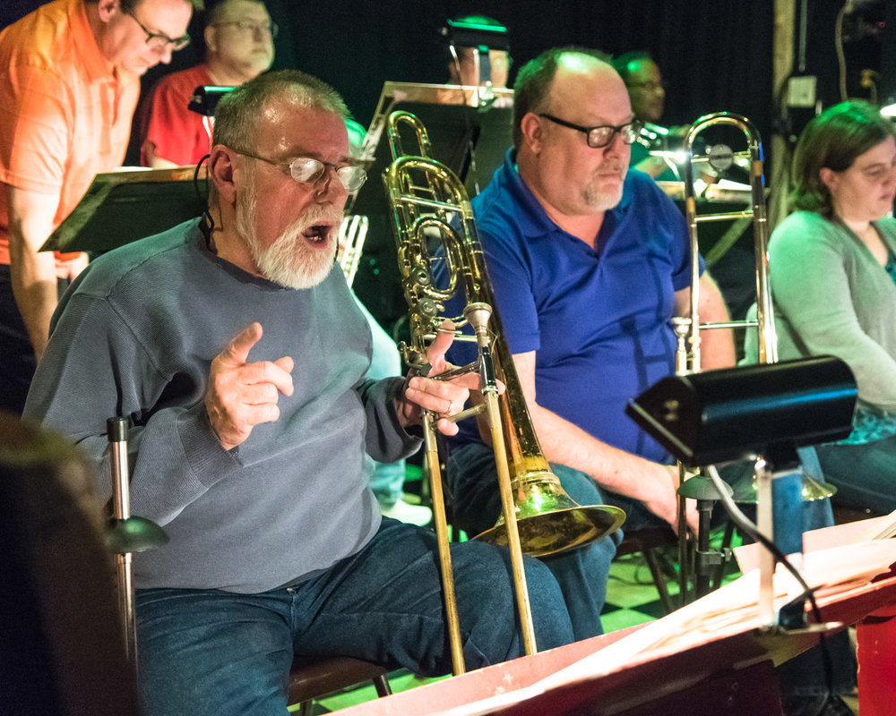Band leader and trombone player Jack Plovanich counts for the band to begin playing during The Parkside Reunion Big Band's bi-weekly performance on April 4 at McAuliffe's Pub in Georgetown.