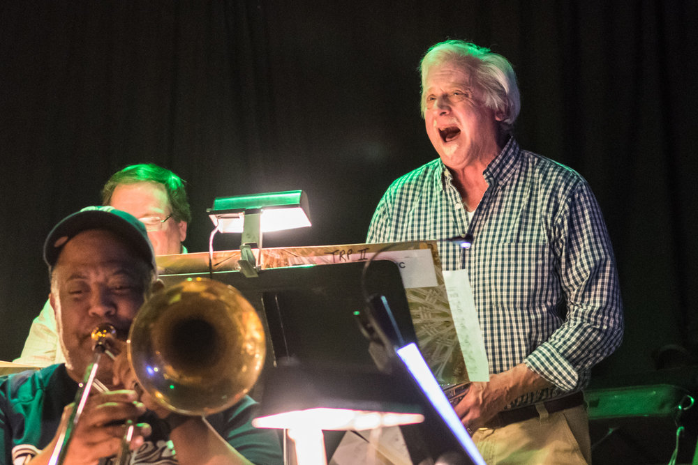 Trumpet player Mike Betz spouts off an improvisational vocal riff over The Parkside Reunion Big Band's last song at their bi-weekly performance at McAuliffe's Pub on April 4.