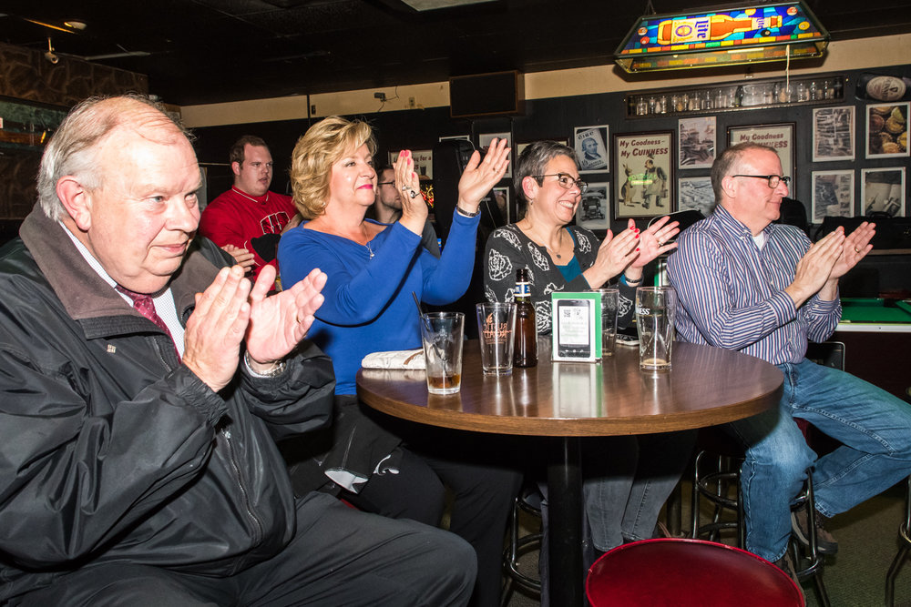Bar guests (Left to right) Tom and Patty Hammer, from Milwaukee, and Katie and Carl Mattheson, from Racine, enjoy the jazz selections of the The Parkside Reunion Big Band's performance at McAuliffe's Pub on April 4.