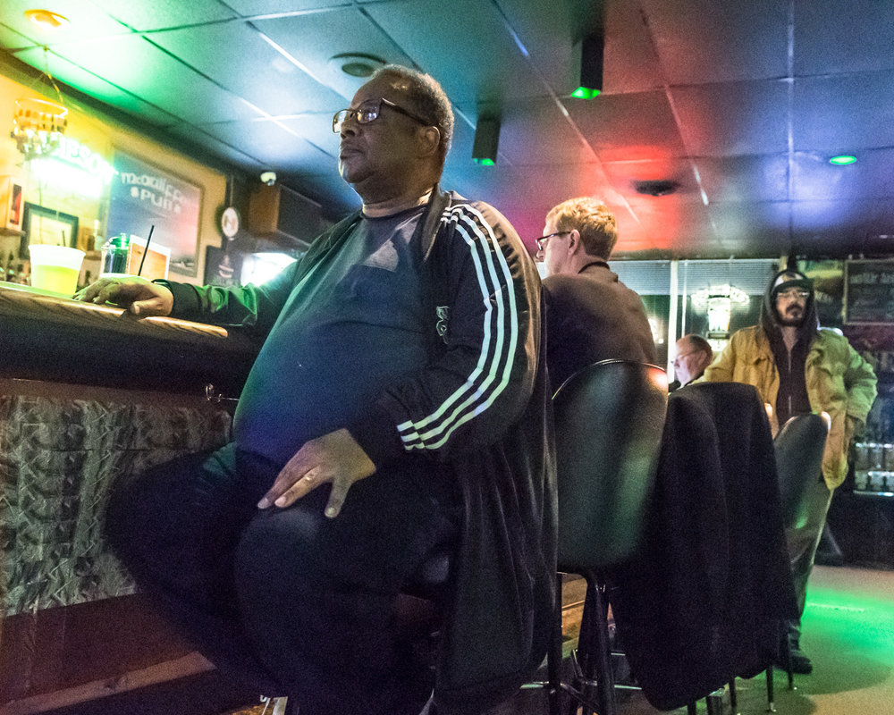 Trumpet player Allen Johnson takes a break at the bar of McAuliffe's Pub during the The Parkside Reunion Big Band's performance