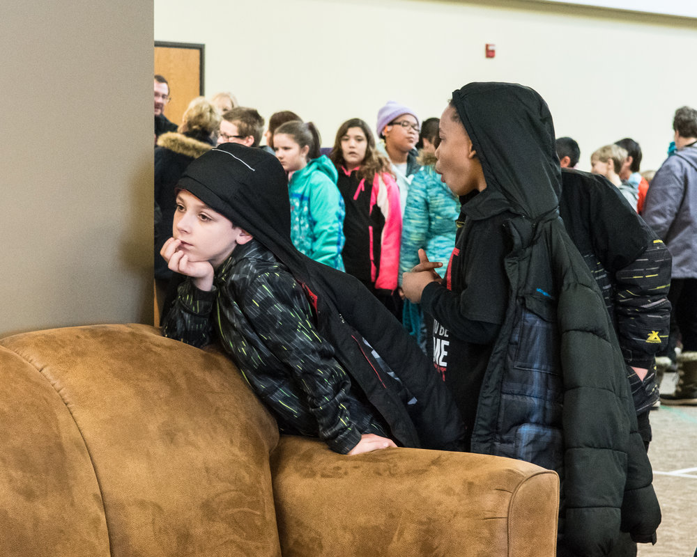 Jacob Ellis of Giese Elementary school patiently waits with his classmates to be let into the Concert for Fifth Graders at Grace Church.