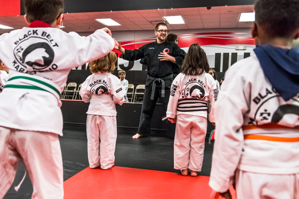 Head Instructor Alan Klingenmeyer, Racine, greets his smallest Karate class, the Little Dragons at their weekly class at Black Belt Karate in downtown Racine Friday night.