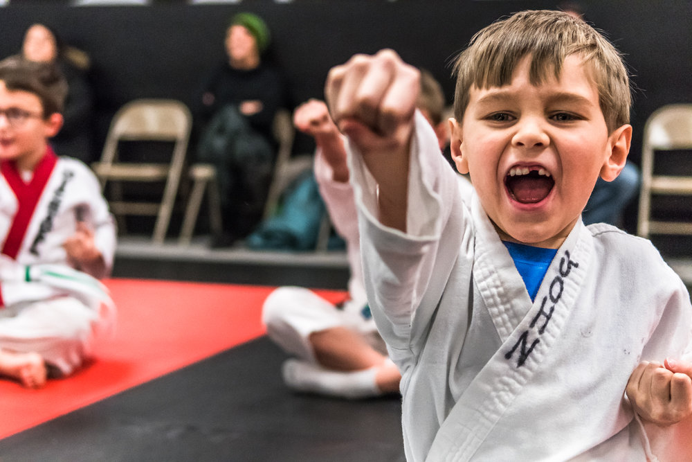 John Borgardt, 6, Racine, performs practice punches with his Little Dragons karate class at Black Belt Karate in downtown Racine Friday night.