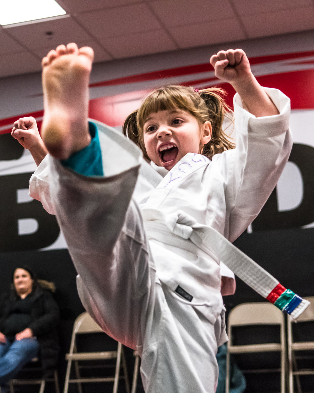 Five year old Lucy Worrell, Racine, performs a high kick in the first practice rounds of her Little Dragons karate class at Black Belt Karate in downtown Racine Friday night.