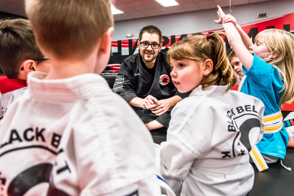 Head Instructor Alan Klingenmeyer, Racine, asks his Little Dragons class what their goals are during their Friday night class at Black Belt Karate in downtown Racine.
