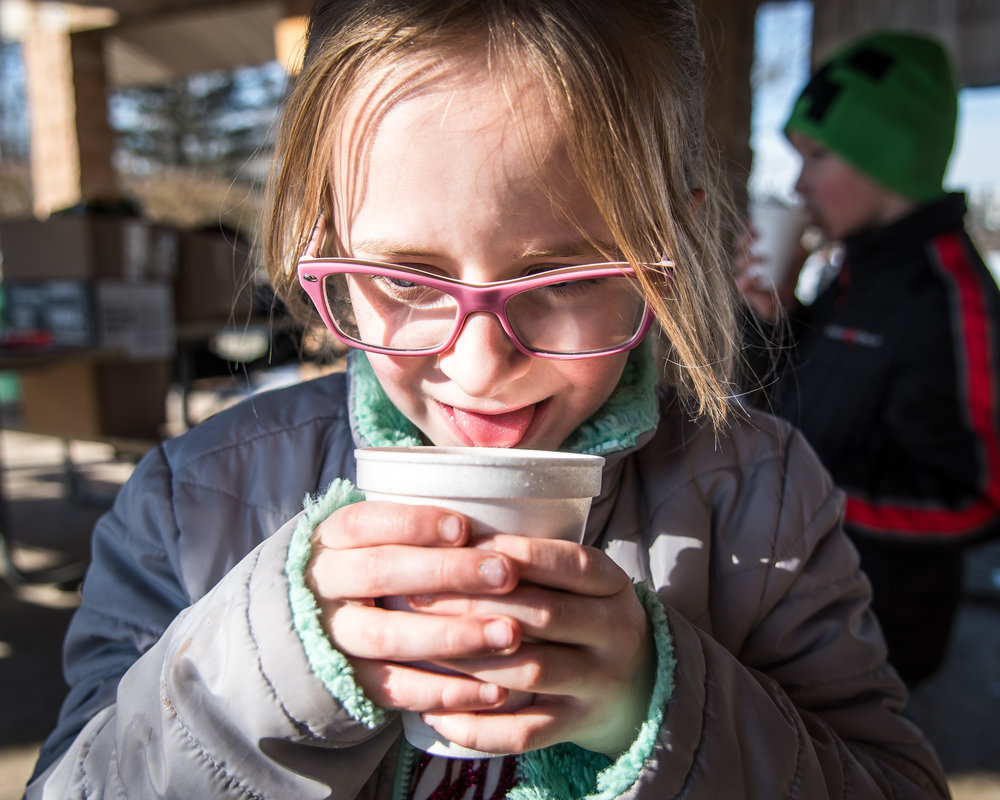 Josie Ehlen, 6, takes her first sip of a piping hot cup of hot chocolate at Burlington's Hot Chocolatefest Saturday afternoon.
