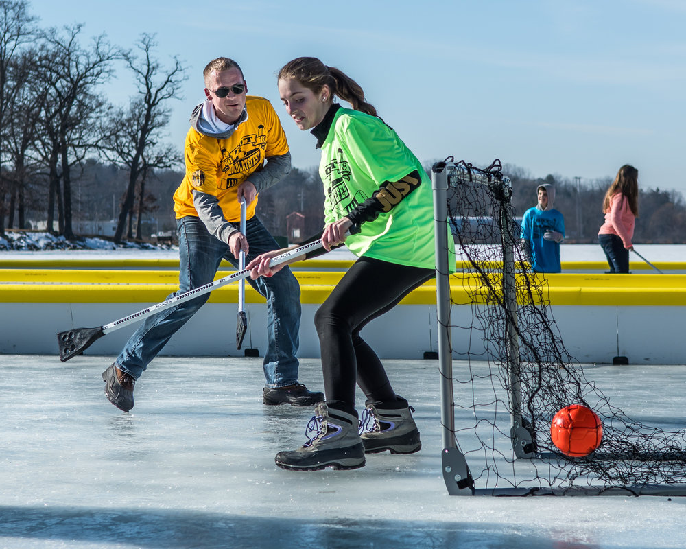 Levi Katelsen, Burlington, scores a point on Cheyenne Cole, 14, during an adults versus kids game of Broom Ball on Echo Lake during Burlington's Hot Chocolatefest Saturday afternoon.