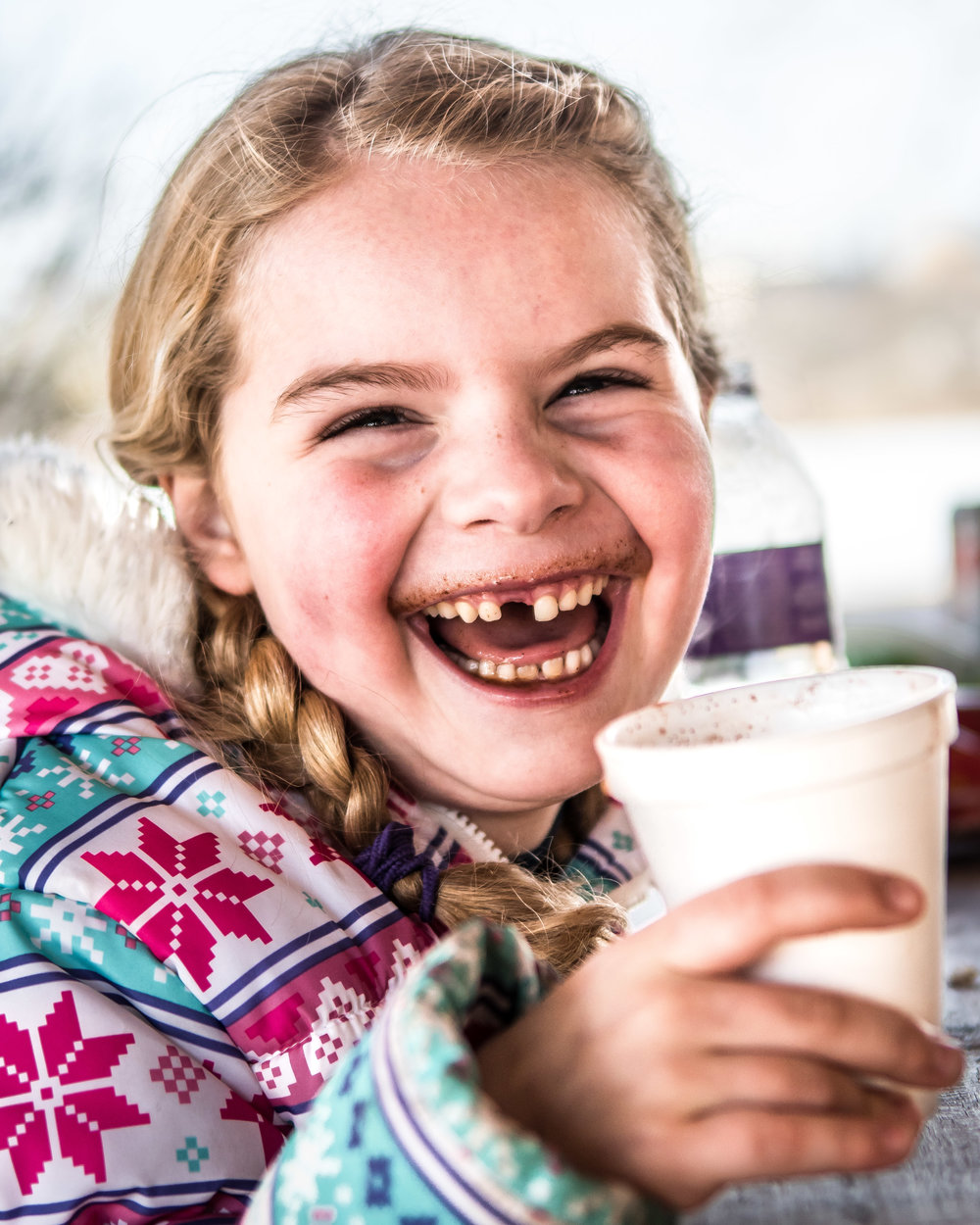 All smiles - Elizabeth Kordus, 6, shows her missing front tooth with a hot chocolate mustache while enjoying her hot chocolate during Burlington's Hot Chocolatefest Saturday afternoon.