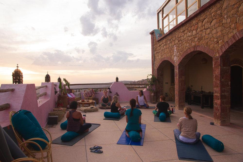 Sunset yoga in Tamazirt by Amayour
