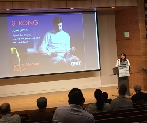 CIRM CEO, Dr. Maria Millan, updates the attendees on the progress of the state agency.  In the slide behind her is former Santa Clara Valley Medical Center patient, Jake Javier, is shown.  Jake suffered a cervical spinal cord injury in June 2016.