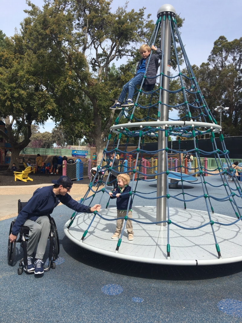 Chris at the Magical Bridge Playground in Palo Alto with sons Christopher (at the top) and Kellan