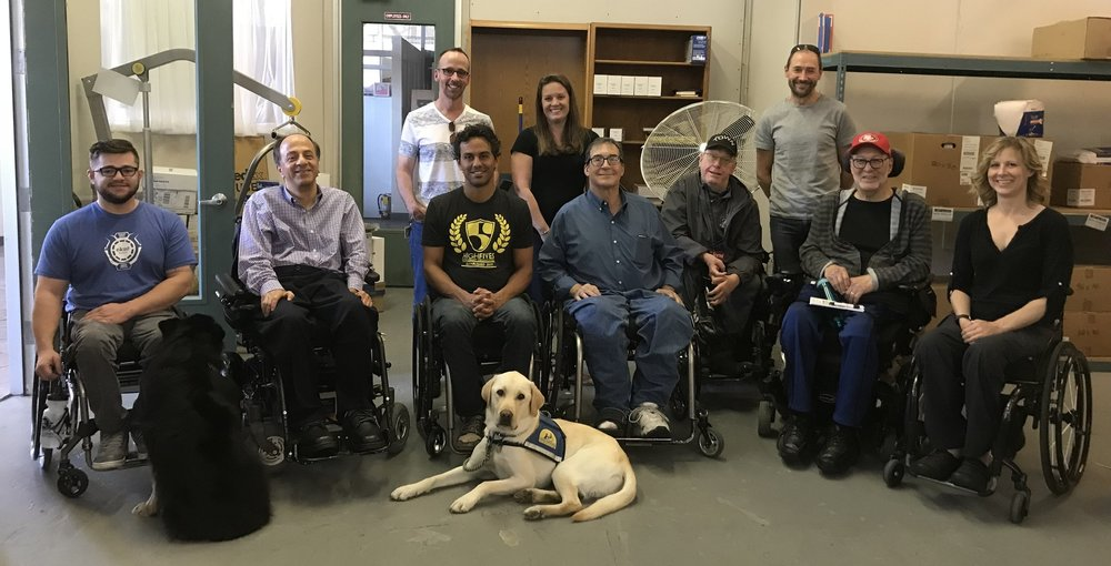 From left to right: Matt Tilford, Franklin Elieh, Arash Bayatmakou, Carl McGrew, Nils Jorgensen, Stan Kosloski, Char Vine. Back row from left to right:  Tom Shankle, Erin Hallett, Nick Struthers. Dogs on the floor from left to right:  Foxy and Tortilla