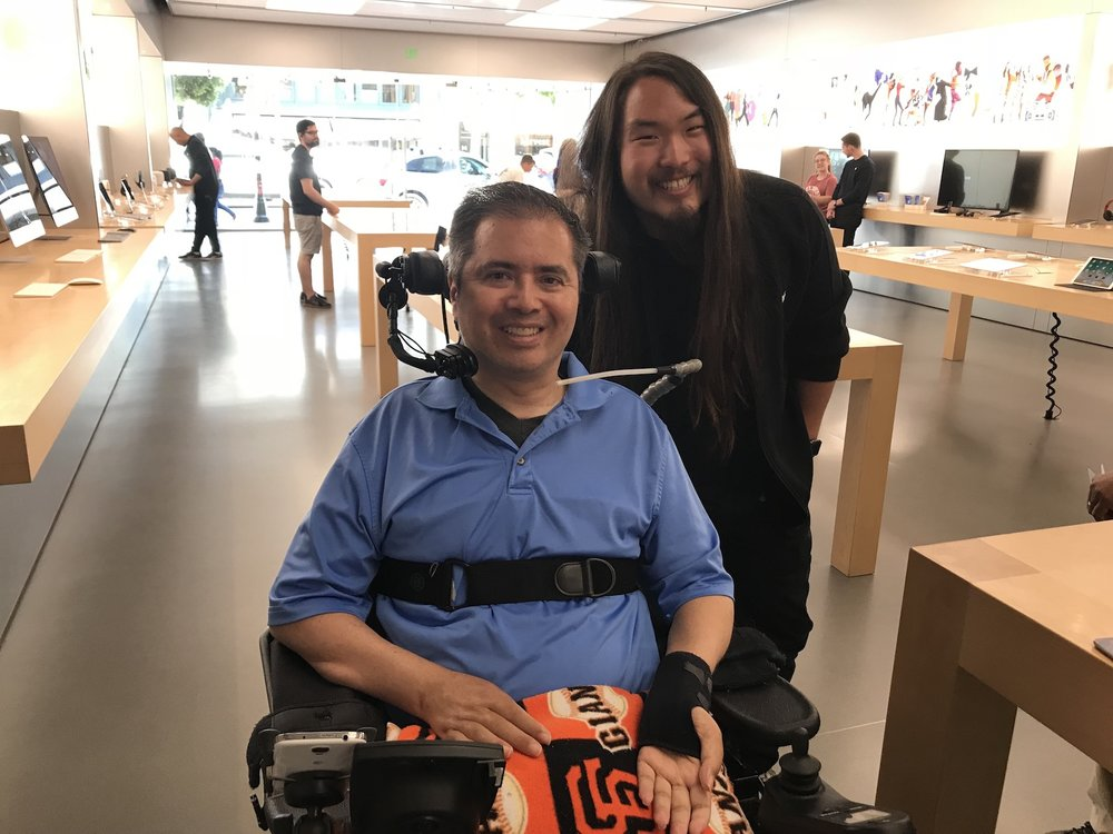Chris Bergevin, a C4 quadriplegic and Apple store's Pat Kusumoto