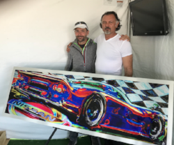 On the left, NorCal SCI co-founder, Nick and artist Mio standing in front of the Nissan race car-inspired metallic art