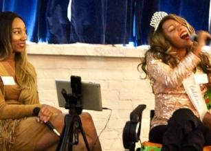 Krystina Jackson sings as her sister, Robyn, looks on.