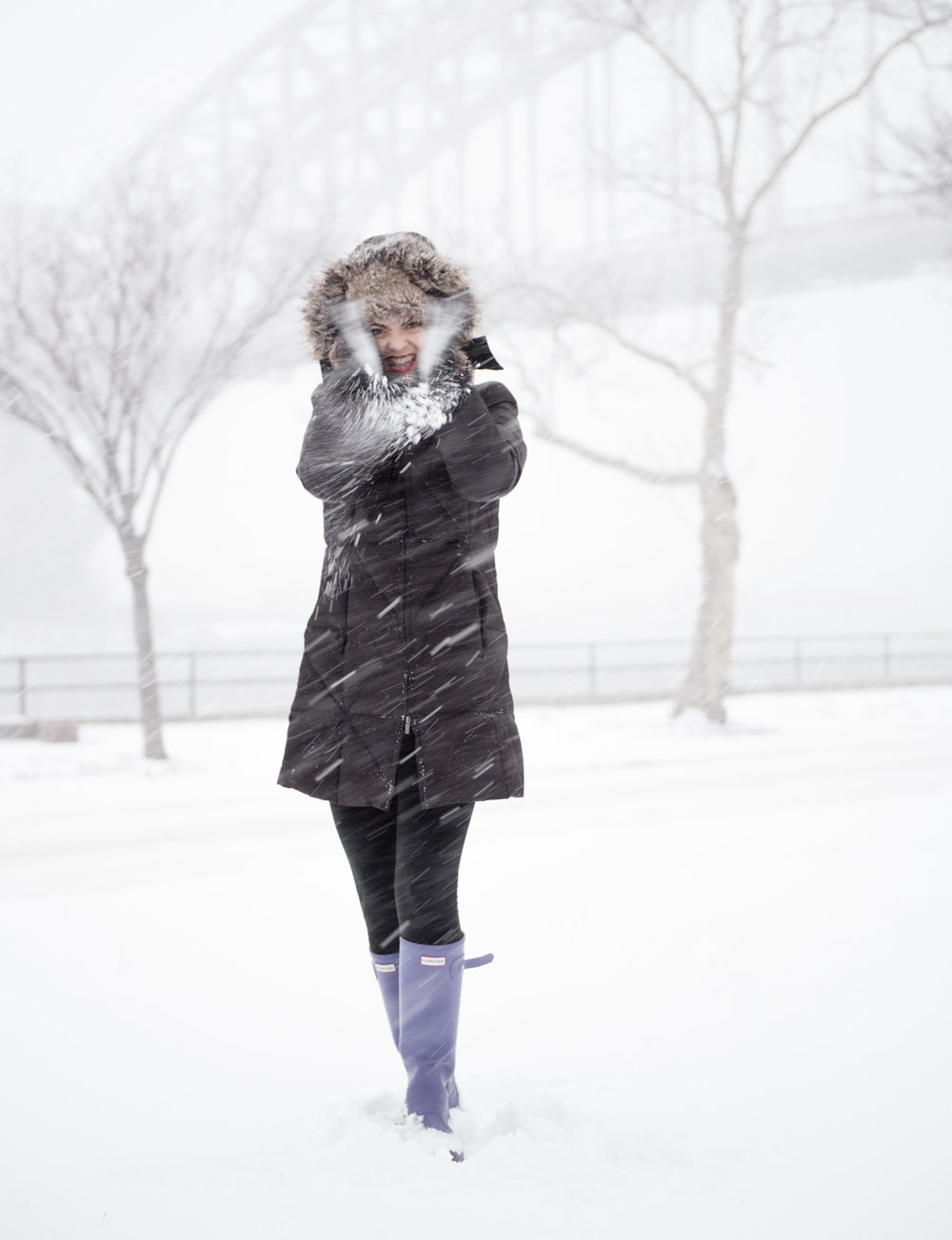 A Social Media Photography example of using weather (a snowstorm) to showcase the fun loving personality of Entrepreneur, Kim Caldwell. Taken in Astoria, New York City.