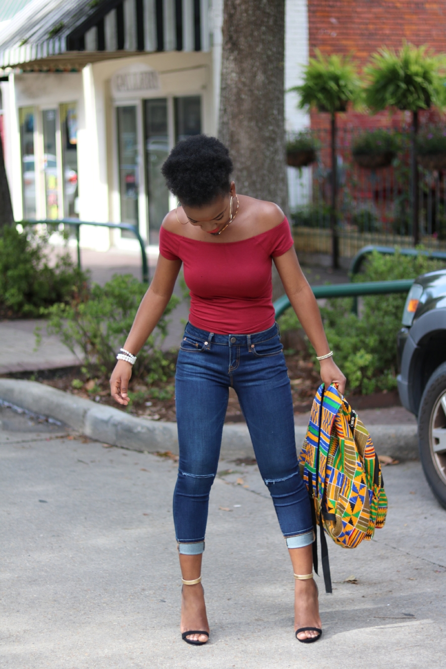 cropped distressed jeans with afro puff