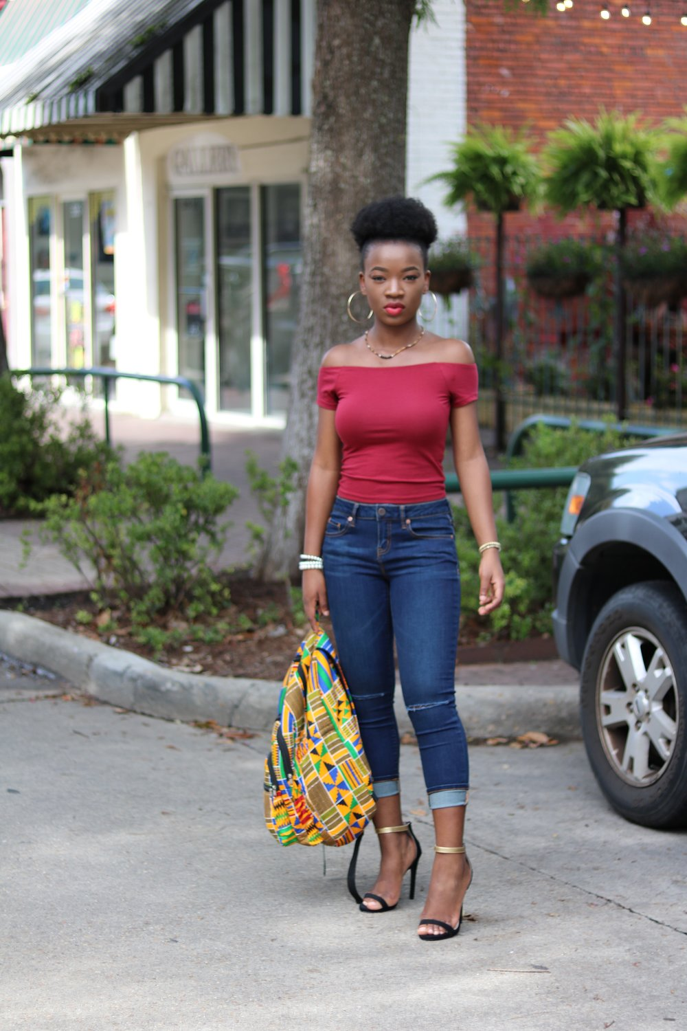 Black girl afro puff distressed jeans