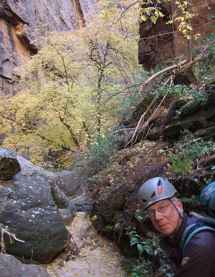 Tom doing his best Fluted Walls imitation. (Mystery Canyon)