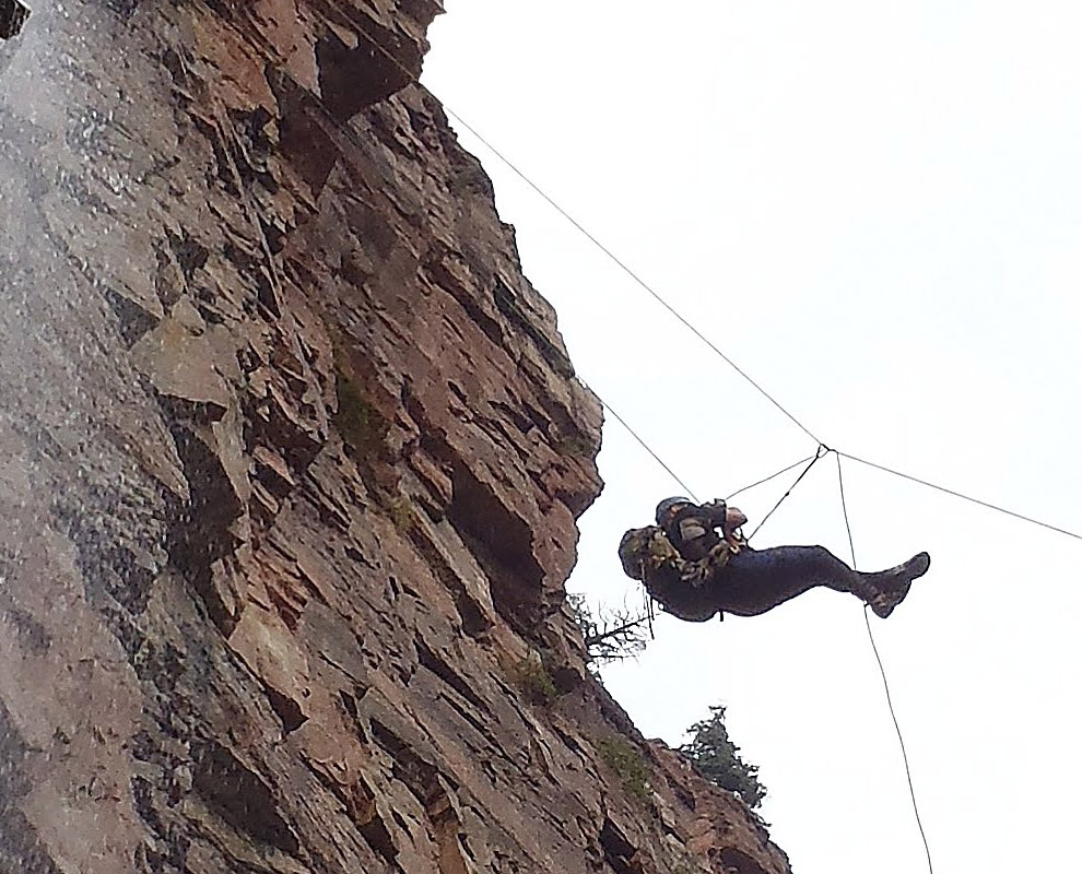 Closeup of Kevin being stuck, showing the ropes crossed