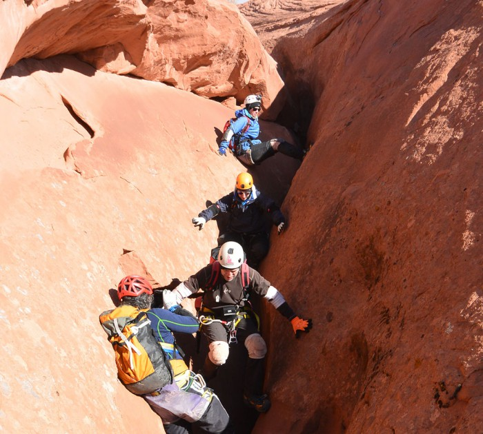 Why hire a guide? - If you're looking for a way to improve your own canyoneering skills, or looking to decrease your stress as a trip leader, hiring a high quality professional guide is a great option.