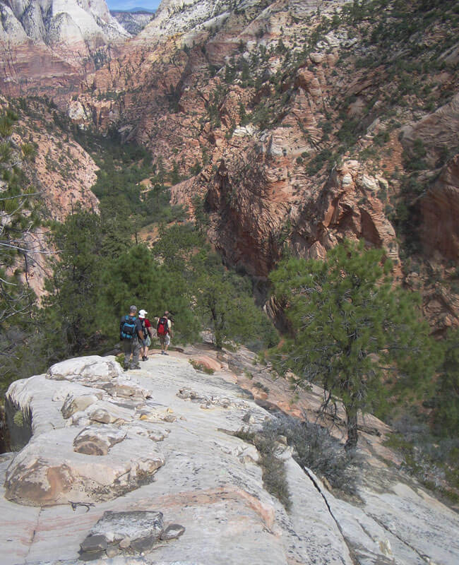 Downclimbing the ramp, Lodge Canyon below