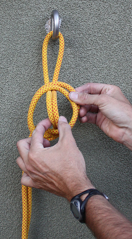 4. Pull the two strands from the anchor through the loop, just far enough to clip a carabiner through it. -