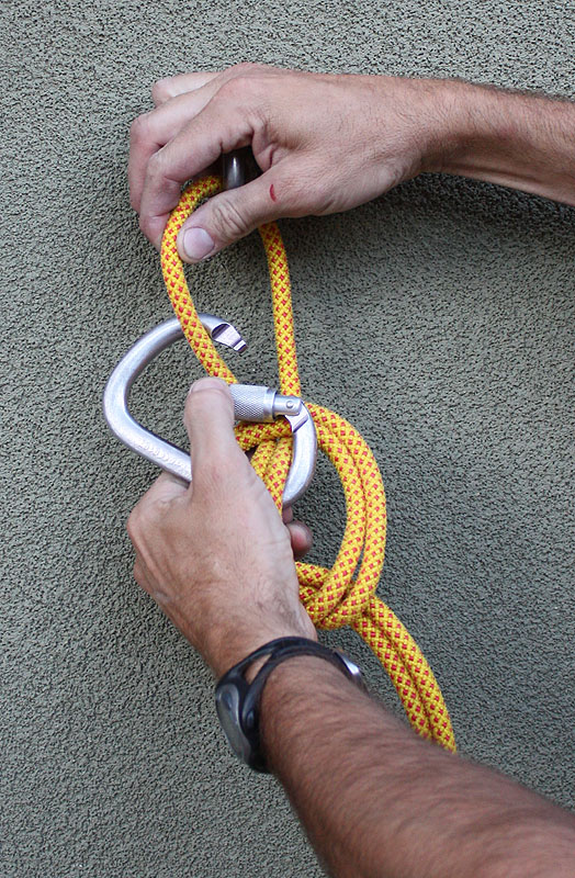 6. Rotate the carabiner around, and clip ONE of the top strands with the carabiner. -