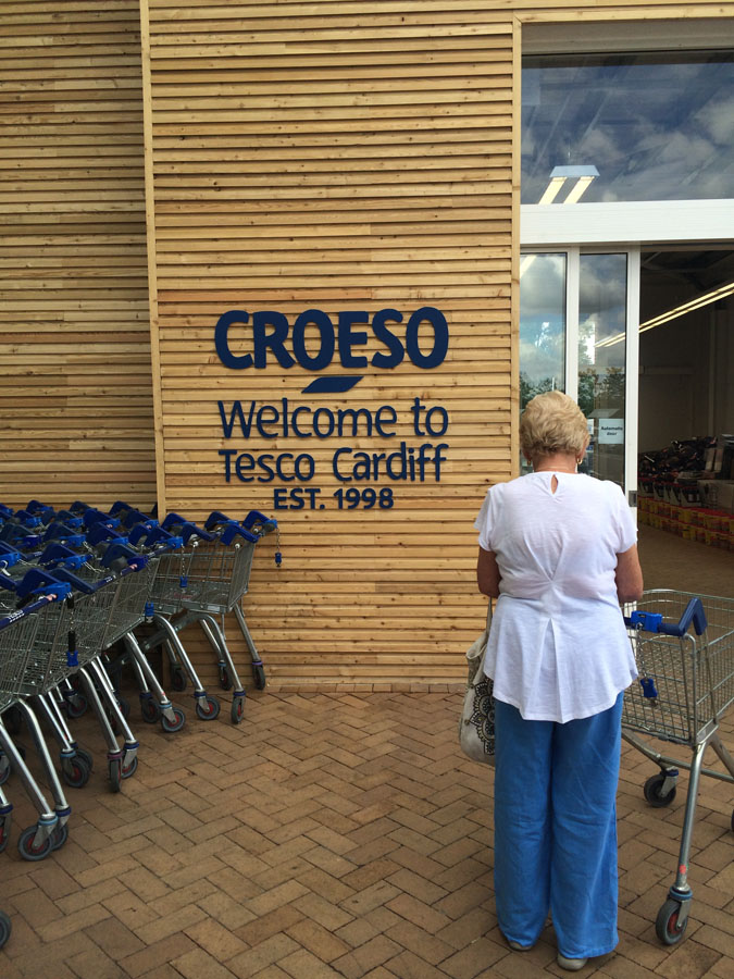 Tesco wood welcome sign
