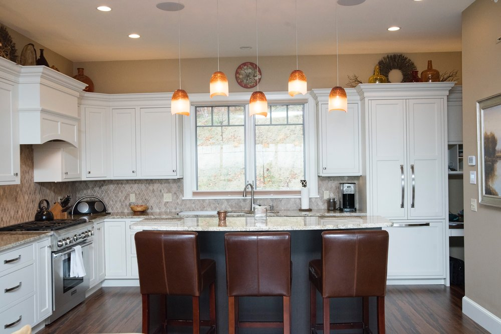 Quechee 2015 The clean lines of this kitchen and unique lighting features highlight balance of colors and warmth.jpg