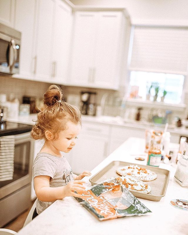 Homemade mini pizzas are probably one of our fave things to do. The kids each can make their own and Mom gets leftovers! Nora is obsessed with throwing gobs of cheese on each pizza and Aiden sneaks the mini pepperonis. 🍕 It definitely gives me a small break in between all the screaming and craziness.