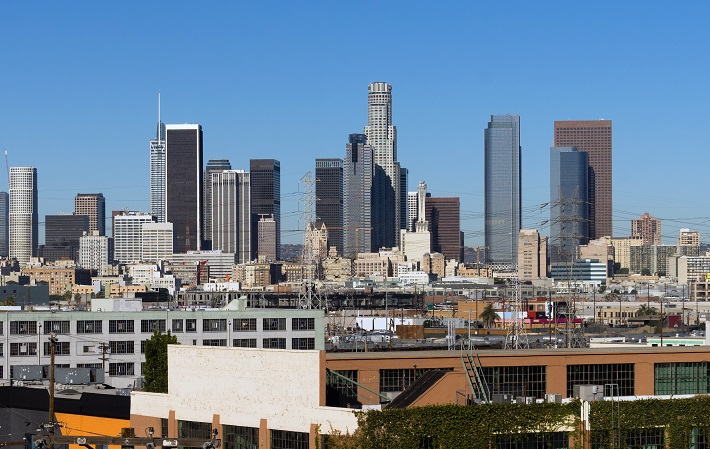 Net asking rents nationwide increased 1.7 percent, to $7.21 per square foot, the highest level since CBRE began tracking rents in 1989. Rents have increased 5.6 percent each year since 2012. (Above: Los Angeles, with warehouses in the foreground.) Photo credit: Shutterstock.com.