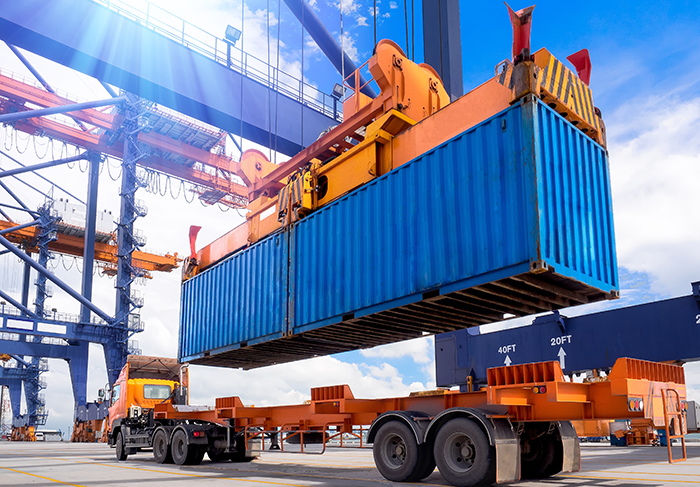 Container being loaded onto truck at port.jpg