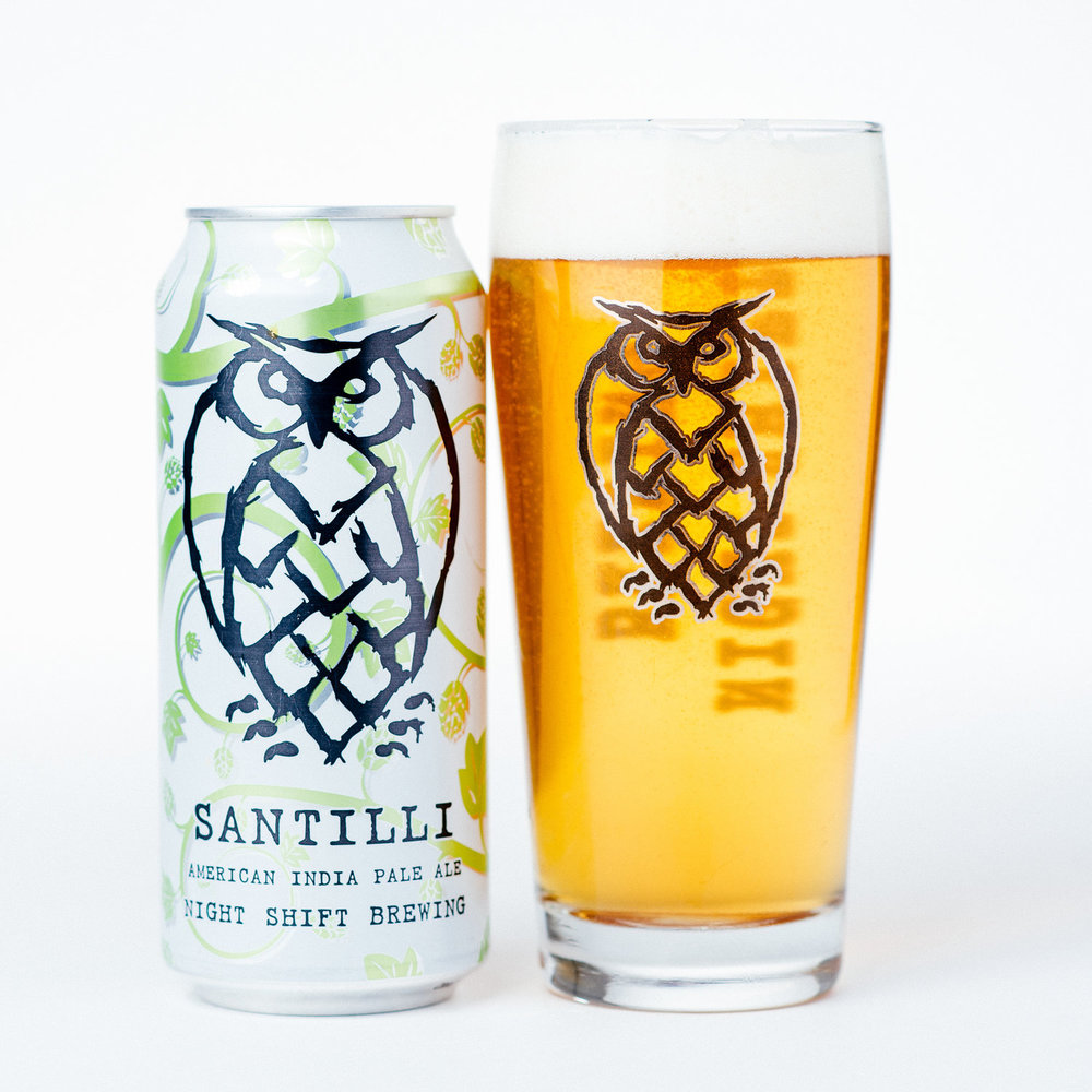 Santilli   | 6.0% ABV | The Flagship IPA for Night Shift. The recipe for Santilli was born out of a batch of Morph, one of Night Shift's rotating IPA series. Santilli is packed with notes of pine and orange zest with a crisp finish. An excellent pairing with sharp cheeses and spiced meats.