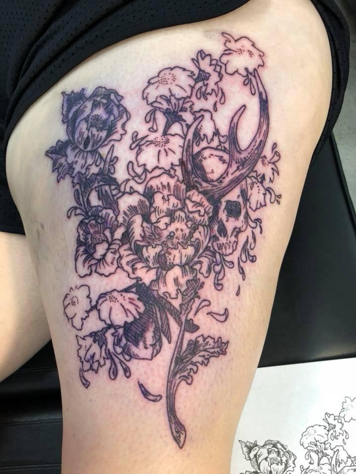 Floral bones tattoo