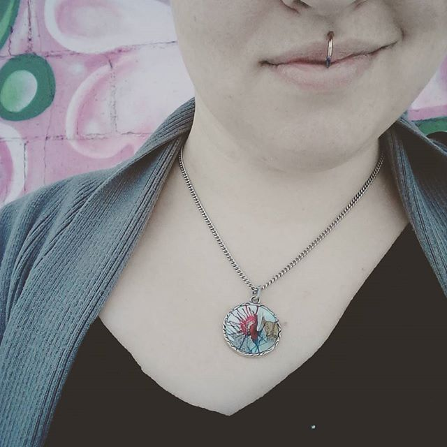 out looking at local murals, wearing my favorite mosquito necklace
