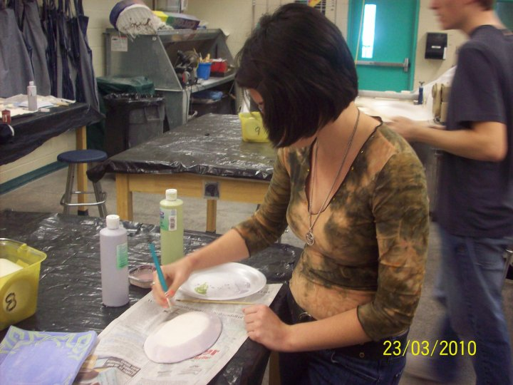 Grumpy Aisling in high school, working on a pottery bowl. There's seriously no good pictures of me from back then. :/